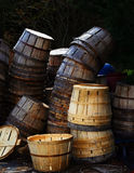 Bushel Baskets. Used and new bushel baskets stacked behind a seafood market stock photography