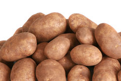 Bushel of potatoes. Dramatic image of a bushel of freshly dug potatoes royalty free stock images