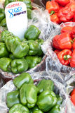 Bushels of green and red peppers Stock Photography