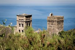 Two towers of Monasterio de Sant Pere de Rodes. Bushes on the foreground and monastery of Sant Pere de Rodes in back Stock Photography