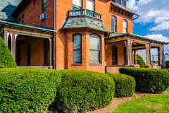 Bushes in front of an old house in Spring Grove, Pennsylvania. Royalty Free Stock Images