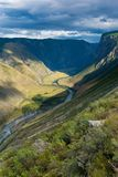 Vertical picture of the road going down, Kato-Yaryk Pass, Altai Republic, Russia royalty free stock photos