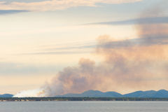 Bushfire near Queensland`s Capricorn Coast, Australia. View of a bushfire near Yeppoon as seen from Rosslyn Bay in Queensland, Australia Royalty Free Stock Photography