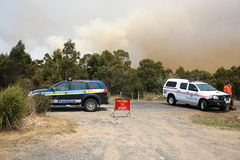 Bushfires in Tasmania. Police and State Emergency Service at the Road to Coles Bay. Tasmania. Australia Royalty Free Stock Photo