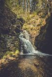 Bushkill Falls in Poconos, PA, surrounded by lush fall foliage stock photo
