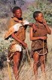 Bushman. Two indigenous bushman in the Kalahari desert from San Tribe, Botswana. The San bushmen indigenous community of Southern Africa, whose territory spans Royalty Free Stock Images