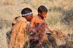 Bushman. Two indigenous bushman in the Kalahari desert from San Tribe, Botswana. The San bushmen indigenous community of Southern Africa, whose territory spans Stock Photo