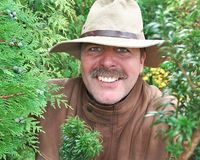 Bushman. Man Parts Trees Royalty Free Stock Photography