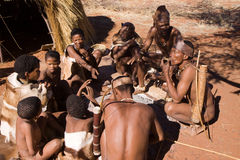 Bushman family. Sitting around a fire in namibia Stock Photography
