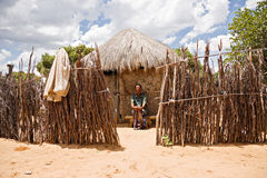 Bushman and his hut Royalty Free Stock Photos