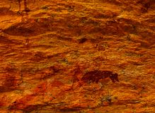 Bushman paintings at Rostock - Namibia. Bushman painting on sandstone wall. Drawing of animals and bushmen khoi-san are clearly visible. Rock art were used to stock photo
