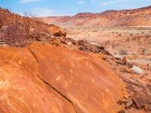 Bushman prehistoric rock engravings in Twyfelfontein, Namibia stock photo