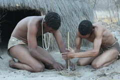 Bushmen lighting fire Stock Photography