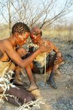 Bushmen making fire. The Bushmen, like the other populations that are as ancient as the African continent itself, today risk being thrown off their land and risk Royalty Free Stock Photography