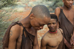 Bushmen in Namibia. Three bushmen in kalahari desert in Namibia, they are the indigenous people of Southern Africa Stock Photos