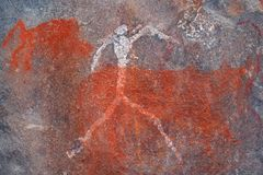 Bushmen rock painting. Bushmen san rock painting of a human figure and animals, South Africa Stock Images