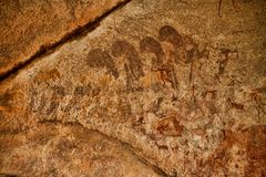 Bushmen rock painting of human figures and antelopes, giraffe of the Matopos National Park, Zimbabwe. The Bushmen rock painting of human figures and antelopes Royalty Free Stock Image