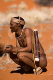 Bushmen. San, demostration how to start a hunting in the early morning Stock Image