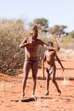 Bushmen san. Bushmen of san tribe demostrating how to hunt in the desert Royalty Free Stock Image