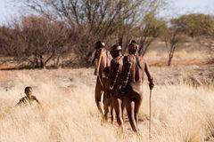 Bushmen sun family. Bushmen san family, demostration how to start a hunting in the early morning in the kalahari desert of namibia Royalty Free Stock Photography