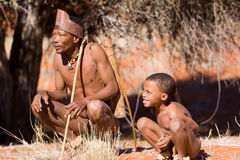 Bushmen sun. Bushmen of san tribe demostrating how to hunt in the desert Royalty Free Stock Image