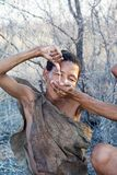 Bushmen woman is drinking the water Stock Photo