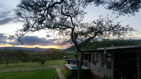Bushveld home. Beautiful African sunset with a tipical bushveld house Royalty Free Stock Image