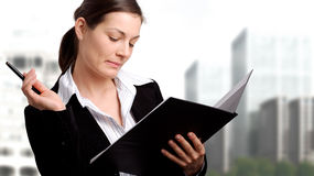 Busibesswoman with open folder Stock Photo