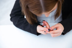 Busiensswoman caring for nails Stock Image