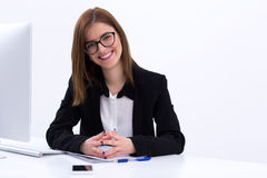 Busiensswoman sitting at her workplace in office Royalty Free Stock Image