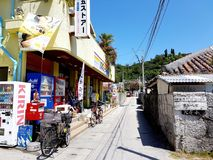 Zamami Main Street in Landscape. The busiest stretch of the main street of the largest village on Zamami island Okinawa, Japan, featuring the popular `105 store Stock Photo