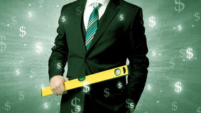 Businassman standing with tool on his hand. Royalty Free Stock Image