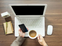 Businees Woman Drinking Coffee And Holding Her Smartphone Royalty Free Stock Image