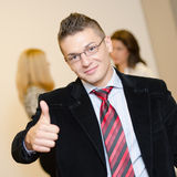 Busineesman giving you his thumb up Stock Images