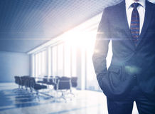 Busineesman in sunny office. Business man in contemporary office stock photography