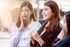 Busineeswomen with money. Asian businesswomen with colleague hold money for success stock photo