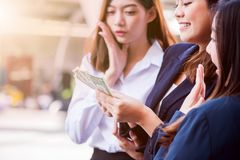 Busineeswomen with money. Asian businesswomen with colleague hold money for success royalty free stock photo