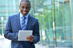 Busines executive smiling with tablet pc Royalty Free Stock Images