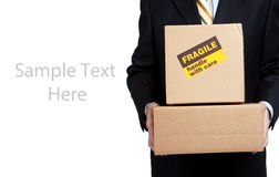 Busines man holding box with copy space Royalty Free Stock Photo