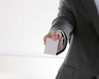 Busines man holding name card on black Royalty Free Stock Image