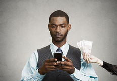 Busines man using smart phone, while offered financial reward Stock Images