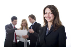 Busines woman with her colleagues. Portrait of a successful business team. The models are real business people royalty free stock photo