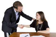 Businesman and businesswoman shaking hands Stock Photo