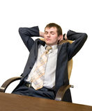 Businesman  dreams. Man in the office of resting in a chair with eyes closed Stock Photo