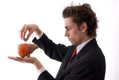 Businesman e seu banco piggy Imagens de Stock Royalty Free