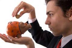 Businesman e seu banco piggy Fotos de Stock Royalty Free