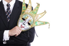 Businesman holding white mask Stock Image