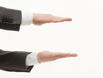 Businesman's palms showing middle size Stock Images