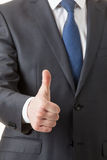 Businesman showing thumd up sign Stock Images