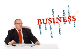 Businesman sitting at desk Stock Photos